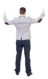 Back view of  business man shows thumbs up. Royalty Free Stock Images