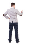 Back view of  business man shows thumbs up. Stock Images