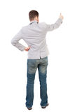 Back view of  business man shows thumbs up Stock Photo