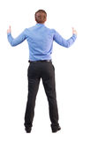 Back view of  business man shows thumbs up. Royalty Free Stock Image