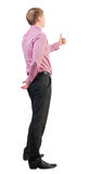 Back view of  business man shows thumbs up Stock Images