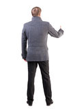 Back view of  business man shows thumbs up Stock Photos