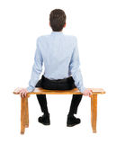 Back view of business man sitting on chair. Royalty Free Stock Image
