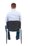 Back view of business man sitting on chair. Royalty Free Stock Photos