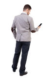 Back view of business man in suit  talking on mobile phone. Royalty Free Stock Photography