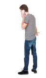 Back view of business man talking on mobile phone. Royalty Free Stock Photo