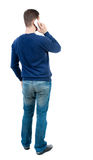 back view of business man uses mobile phone. Royalty Free Stock Image