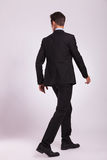 Back view of business man walking Stock Photos