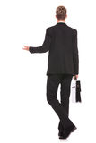 Back view of a business man welcoming Royalty Free Stock Photos