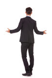 Back view of a business man welcoming you. Full body back view of a business man welcoming you on white background Stock Images