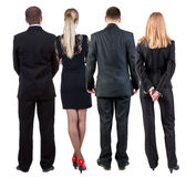 Back view of business people looks at wall. Royalty Free Stock Image
