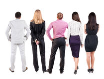 Back view of  business team looks at wall. Stock Image