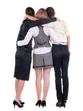 Back view of business team work. Three beautiful young bussineswoman pointing.Rear view people collection. backside view of person. Isolated over white Royalty Free Stock Photography