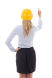 Back view of business woman in builder helmet writing something Royalty Free Stock Photos