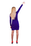 Back view of  business woman in dress with hand u Stock Photo