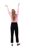 Back view of  business woman.  Raised his fist up in victory sig Stock Image