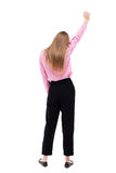 Back view of  business woman.  Raised his fist up in victory sig Royalty Free Stock Photo