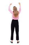 Back view of  business woman.  Raised his fist up in victory sig Royalty Free Stock Image