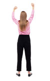 Back view of  business woman.  Raised his fist up in victory sign Stock Photos