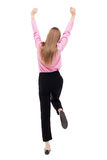 Back view of  business woman.  Raised his fist up in victory sign Royalty Free Stock Photography