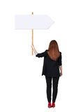 Back view business woman showing sign board. Royalty Free Stock Images