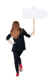 Back view business woman showing sign board. Stock Image