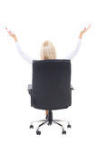 Back view of business woman sitting in office chair and celebrat Stock Images