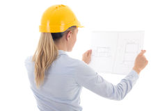 Back view of business woman in yellow builder helmet holding bui Stock Photo