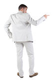 Back view of businessman pointing at wall Royalty Free Stock Photography