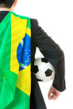 Back view of businessman with soccer ball and brazil flag. Isolated on white royalty free stock photo