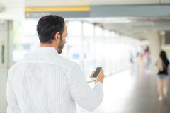 Back view of a of businessman using mobile smartphone. Stock Photo