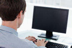 Back view of a businessman working with a computer Royalty Free Stock Photography