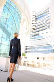 Back view of businesswoman looking at business building Royalty Free Stock Image