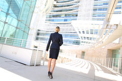 Back view of businesswoman looking at business building Stock Photo