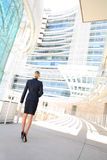 Back view of businesswoman looking at business building Royalty Free Stock Photography