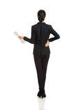 Back view of a businesswoman with paper notes Royalty Free Stock Image