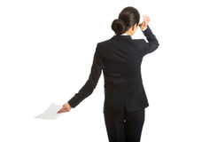 Back view of a businesswoman with paper notes Royalty Free Stock Photo