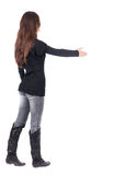 Back view of businesswoman  reaches out to shake hands. Stock Photos