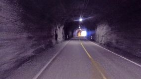 Back view of caravan in Norway highway road entering tunnel. Back view of motorhome caracan driving in Norway highway road entering tunnel stock video footage