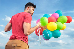 Back view of casual man with balloons Stock Photography