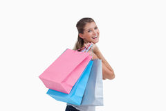 Back view of a cheerful woman holding shopping bags Stock Images