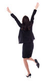 Back view of cheerful young woman in business suit isolated on w Stock Photography