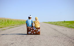 Back View Of Children On The Suitcase Over Royalty Free Stock Images
