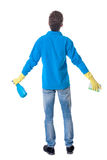 Back view of a cleaner man in gloves with sponge and detergent. Royalty Free Stock Images