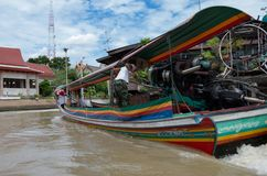 A long boat racing through the canals of Bangkok, Thailand royalty free stock photos