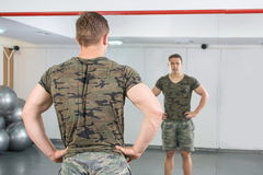 Back view of confident and masculine man at the gym. Back view of a confident and masculine man at the gym Royalty Free Stock Photography