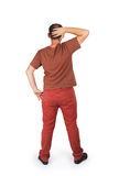 Back view of a confused young casual man with his hand on the ba stock photos