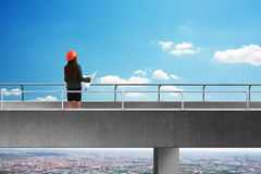 Back view of constructor on bridge Royalty Free Stock Photo