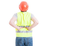 Back view of construtor man with spinal injury. Back view of construtor man wearing protection vest and helmet with spinal injury isolated on white with Stock Image