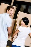 Back view of couple carrying cardboard packages Stock Photo
